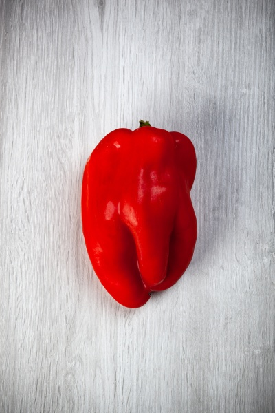 one red sweet pepper on white