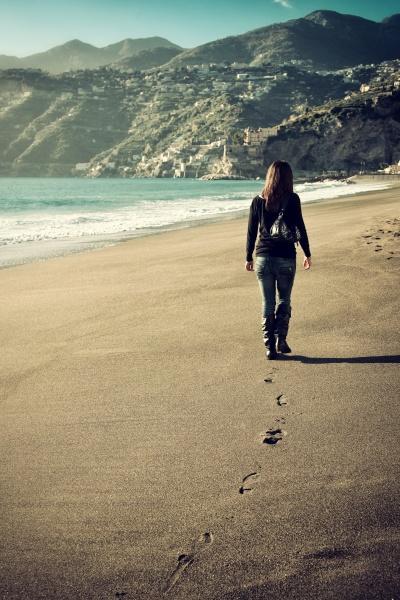 woman walking on an empty beach