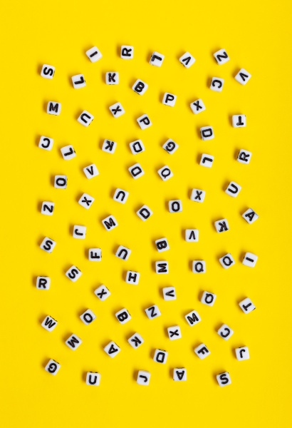 white cubes with letters scattered randomly