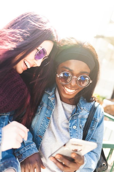 happy multiracial friends in a spring