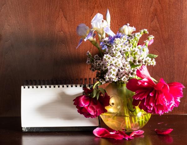 flowers in vase and blank calendar