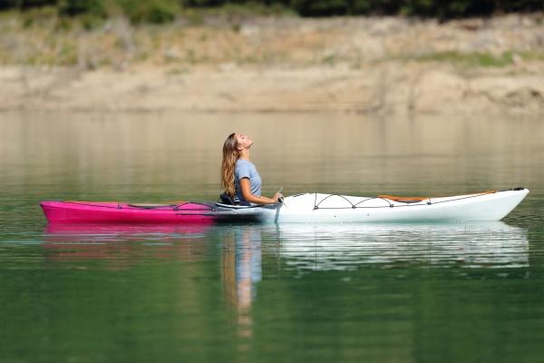 woman in a kayak breathing fresh