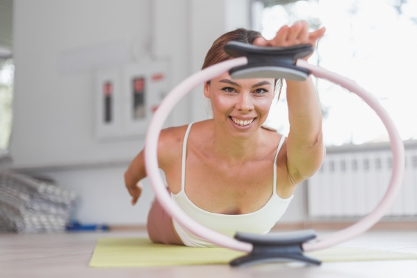 exercises with pilates ring woman aerobics