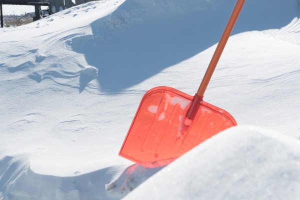a snow shovel is stuck in