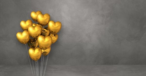 gold heart shape balloons bunch on
