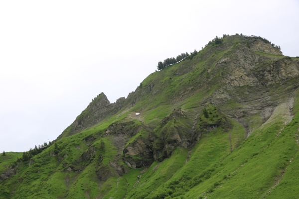 green meadows and rock formations between