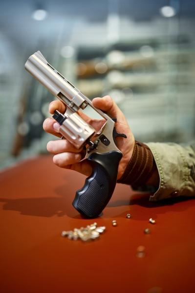 man reload revolver at the counter