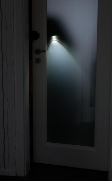 a burglar with a flashlight opens