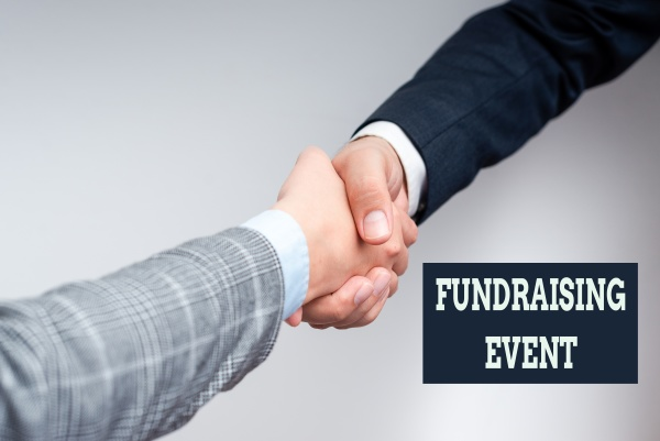 hand writing sign fundraising event business