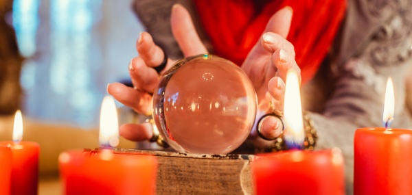soothsayer during a seance with crystal