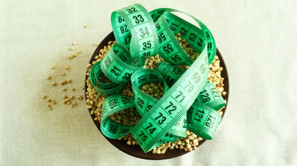 green measuring tape on a background