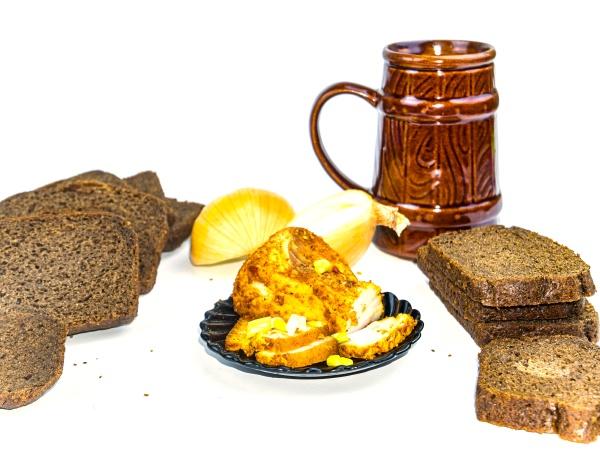 appetizer sliced black bread and lard