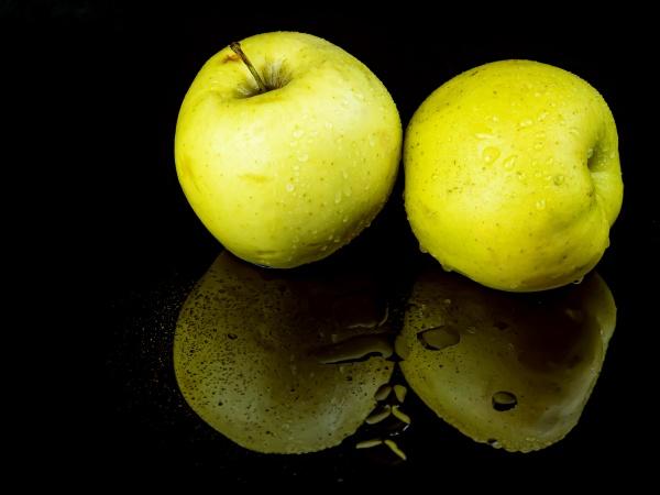 fruit green apple in drops of