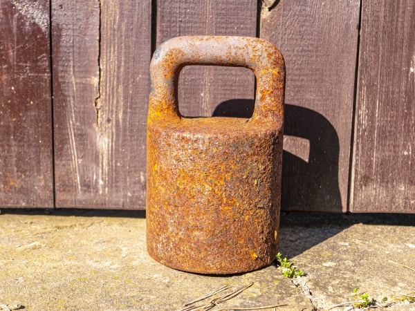 old rusty iron weight for large