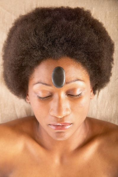 woman with rock on forehead