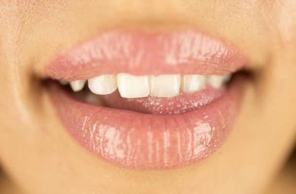 close up of smiling womans lips