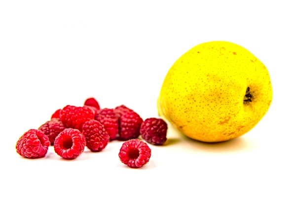 yellow pear and red raspberries on