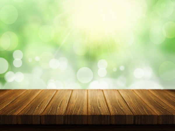 wooden table with defocussed background