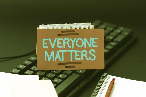 hand writing sign everyone matters