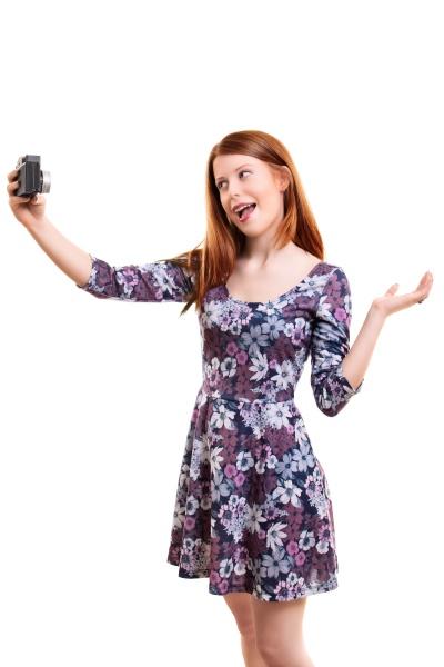 beautiful young woman taking a selfie