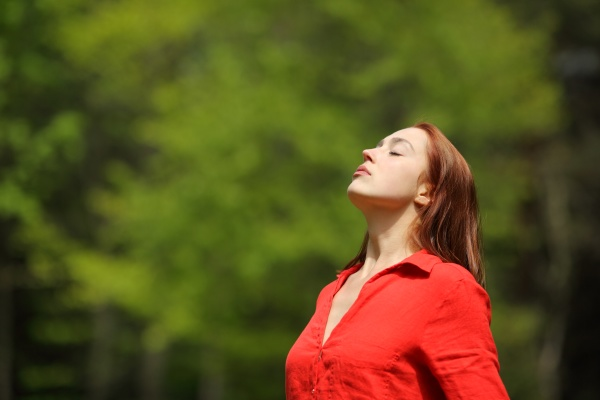 relaxed woman in red breathing fresh