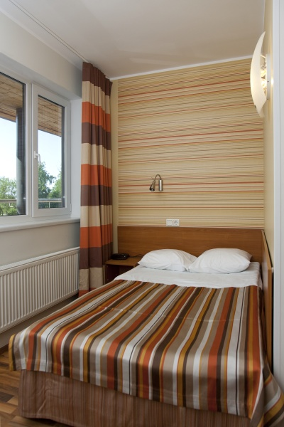 small and colorful hotel room