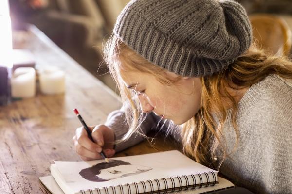 teenage girl in a woolly hat