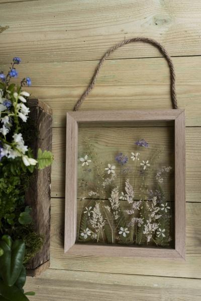 flower arrangement in wooden frame decorations