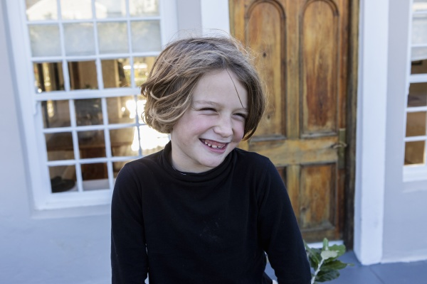 young boy laughing looking sideways head