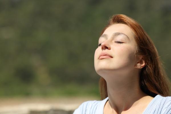 woman relaxing breathing fresh air a