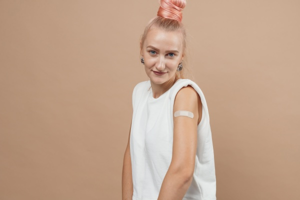 young hipster woman with band aid
