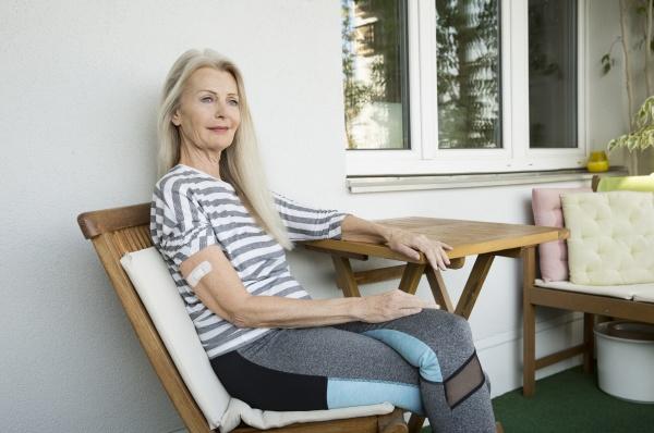 austria vienna senior woman with adhesive