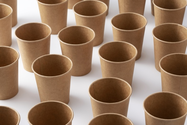 a lot of brown paper cups