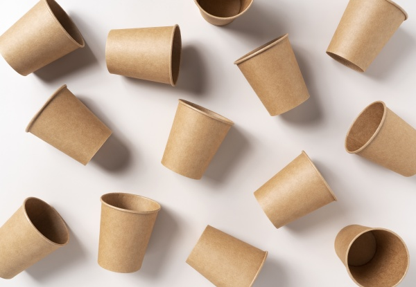 disposable paper cups on a beige
