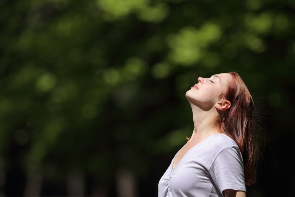 woman breathing and heating under sun