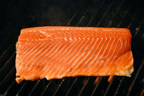 searing and smoking salmon fish fillet