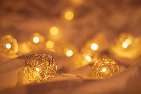 golden blurred christmas lights on rumpled