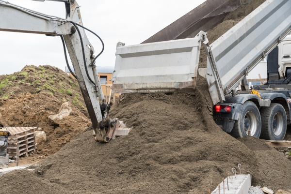 excavator and truck construction industry