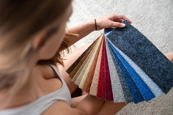 pretty female interior designer choosing flooring
