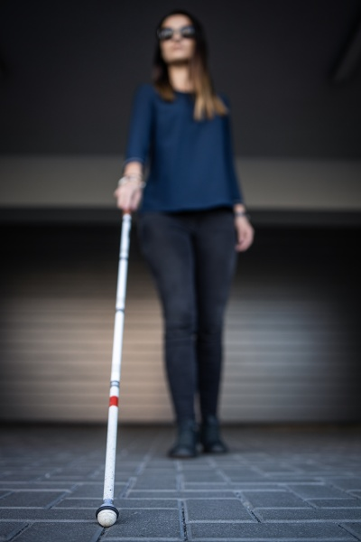 blind woman walking on city streets