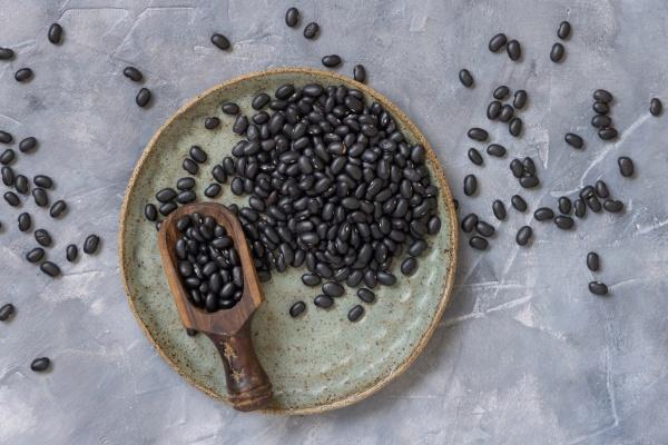plate full of dry black beans