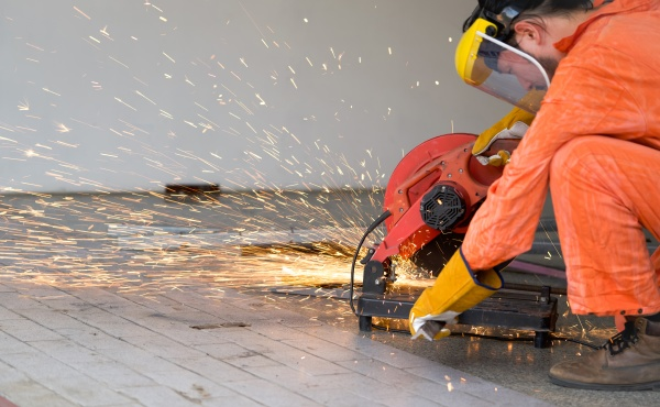 industrial worker cutting the steel to