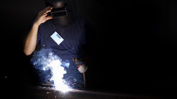 metal industry worker with a staff