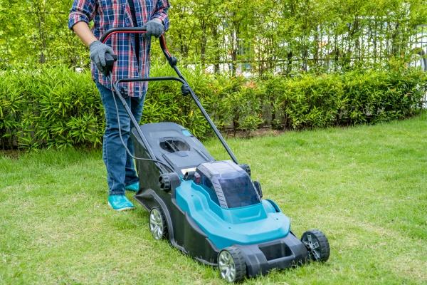 gardener use lawn mover machine cut