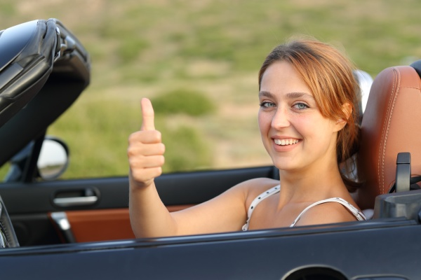 happy car driver gesturing thumbs up