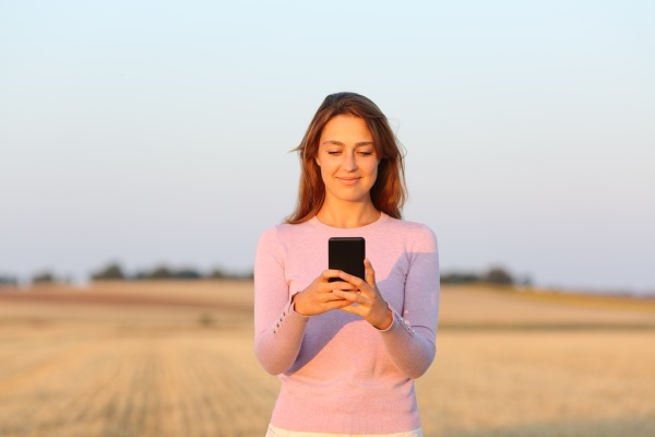 woman using smart phone in harvested