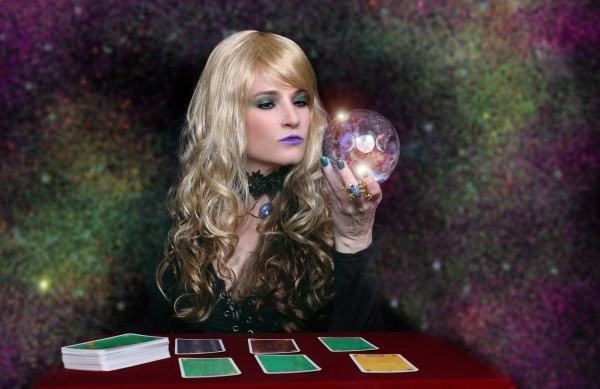 psychic with blond hair crystal ball