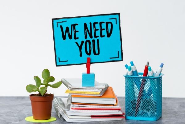 writing displaying text we need you