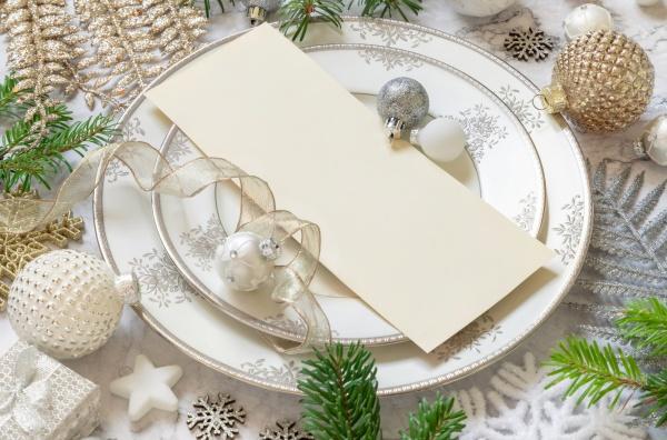 christmas table setting of with menu