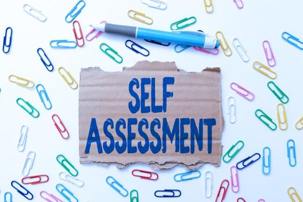 text sign showing self assessment business